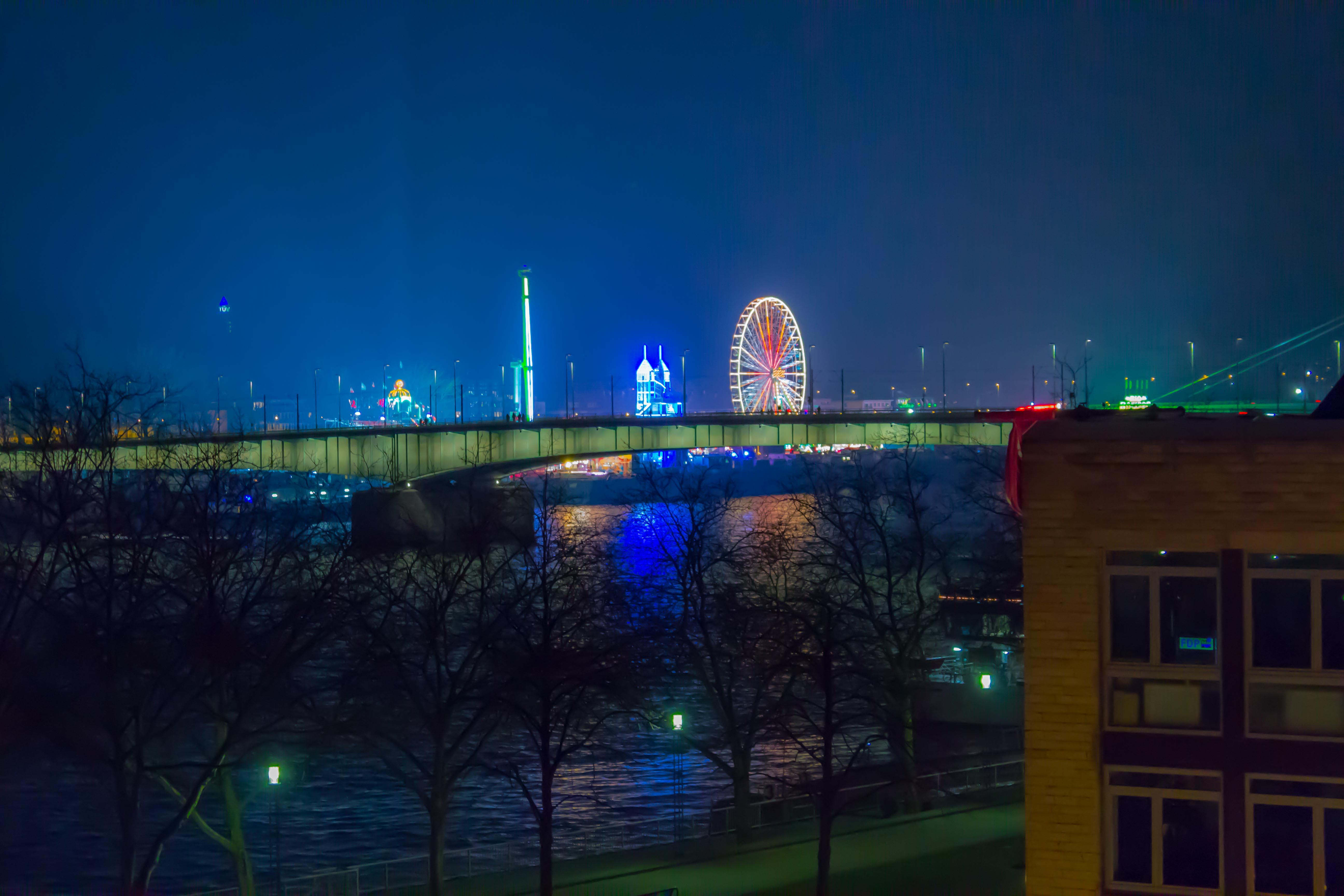 Cologne by night; a funfair across the Rhine