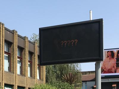 Electronic Street Sign Showing Question Marks